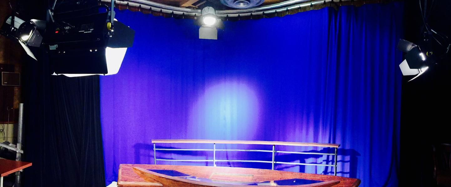 Studio setting with lights and curtain
